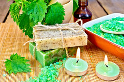 Soap homemade with nettles in mortar on board Royalty Free Stock Photos