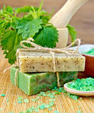 Soap homemade with nettles in mortar on board Stock Photo