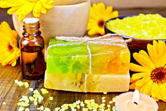 Soap homemade and oil with calendula on board Royalty Free Stock Images