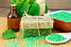 Soap homemade and oil with nettles in mortar Stock Photo