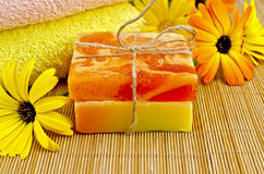Soap homemade orange and yellow with marigold Royalty Free Stock Photos