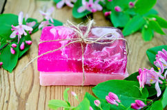 Soap homemade pink with flowers of honeysuckle Royalty Free Stock Image