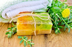 Soap homemade with Rhodiola rosea on board Stock Image