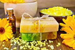 Soap homemade and salt with calendula on board Royalty Free Stock Image