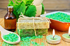Soap homemade and salt with nettles in mortar Royalty Free Stock Image