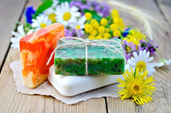 Soap homemade with wildflowers on the board Royalty Free Stock Photos