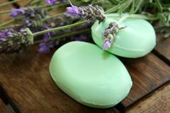 Soap & Lavender. Stalks of fresh purple lavender and bars of green soap Royalty Free Stock Photo