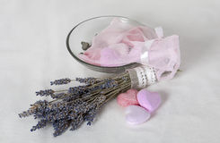 Soap and lavender. Varicolored soap shaped as hearts and a small bunch of dried lavender Royalty Free Stock Photography