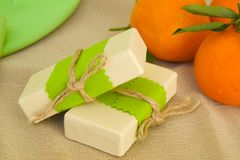 Soap with mandarin essential oil Stock Images