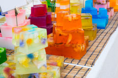 Soap on a market stall. Colorful hand made soap bars on a market stall stock photos