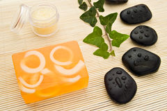 Soap and massage stones Stock Photo