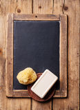 Soap and natural sponge on chalk board Royalty Free Stock Photo