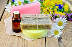 Soap with oil and wildflowers on board Royalty Free Stock Image