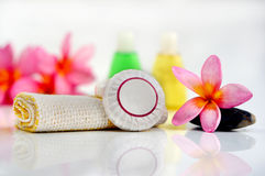 Soap with plumeria flower and toiletries. For tropical wellness spa & aromatherapy concept,  on white background Royalty Free Stock Photos