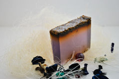 Soap. Purple on a white background Royalty Free Stock Photos