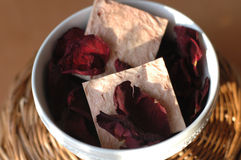 Soap and rose petals Stock Photos