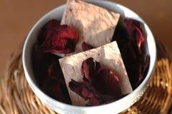 Soap and rose petals Stock Photos