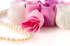 Soap roses and pearl necklace Stock Photo