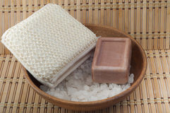 Soap, sea salt in a wooden bowl cleansers Stock Images