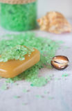 Soap, sea shell and sprinkled bath salt Royalty Free Stock Photos