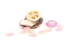 Soap in a seashell, candle, loofah and rose petals Stock Photography