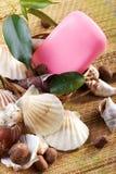 Soap with seashells on straw mat macro Stock Photo