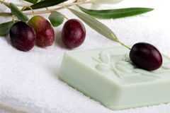 Soap spa set. Spa set - fresh black olives and organic soap over white towel. best suited for relaxing and health commercials stock images
