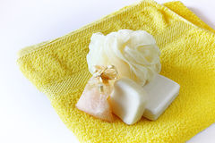 Soap and sponge on towel Stock Photography
