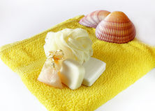 Soap and sponge on towel Stock Photo