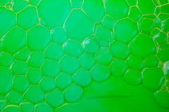 Soap suds extreme closeup creating honeycomb pattern Royalty Free Stock Image