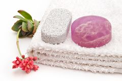 Soap and towel. Algae soap on white towel and one flower royalty free stock images