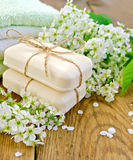 Soap with towel and bird cherry on board Royalty Free Stock Photo