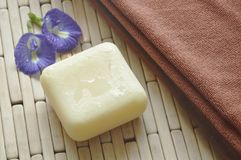 Soap and towel with butterfly pea purple flower on bamboo mat Stock Images