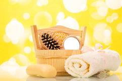 Soap, towel and a hairbrush in the bathroom. On a yellow background stock photography