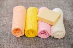 Soap and towel. Shower accessories. Hygiene items. royalty free stock photo