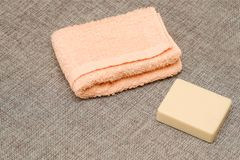 Soap and towel. Shower accessories. Hygiene items. royalty free stock photography