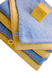 Soap and towels. Blue and yellow bathroom linens with scented french soap. Clipping path included Stock Images