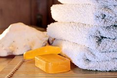 Soap and towels Stock Photos