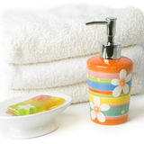 Soap and towels Stock Images