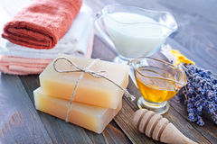 Soap and towels. On a table Royalty Free Stock Images