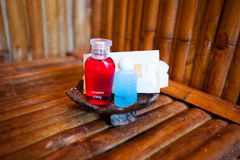 Soap and towels of white on table Royalty Free Stock Photos