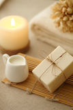 Soap and towels. Wrapped cake of white soap with towels in spa still life Stock Photo