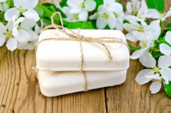 Soap with white flowers of apple on board Royalty Free Stock Image