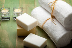 Soap and white towels Royalty Free Stock Images