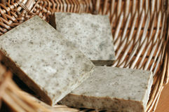 Soap and a wicker basket Royalty Free Stock Images
