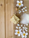 Soap,wooden ball,stones and tiare flowers Royalty Free Stock Photos