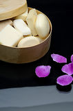 Soap in wooden case with rose. On reflected surface Royalty Free Stock Images