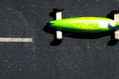 Soapbox car racing at soap box derby. High angle view of green soapbox car taking part in soap box derby Royalty Free Stock Photography