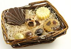 Soaps. Scented glycerin soaps on a basket surrounded by white background Royalty Free Stock Images