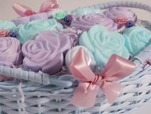 Soaps in the basket. Pastel colorful soaps in a basket with a bow Stock Photo